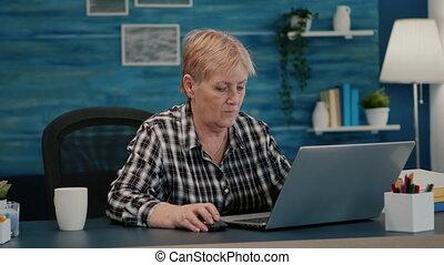 Senior mature older woman watching business training