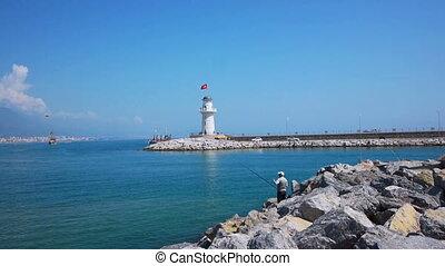 Senior men fishing in Alanya bay near lighthouse - ALANYA,...