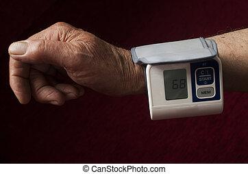 Senior Men Holding Blood Pressure Gauge