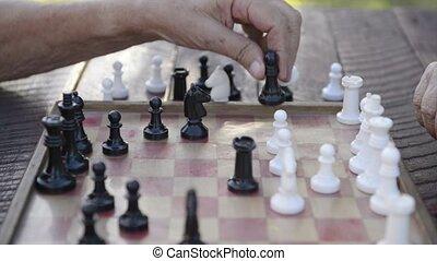 Senior men playing chess game