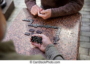Senior men playing domino outdoor
