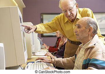 Senior men using computer