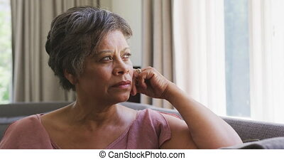Senior mixed race woman looking away - Senior mixed race ...