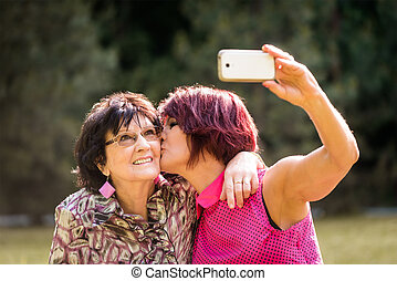 Senior mother and daughter selfie