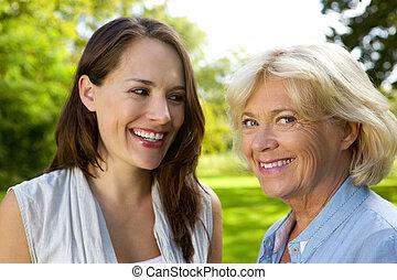 Senior mother smiling with older daughter