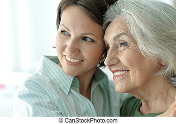 senior mother with adult daughter