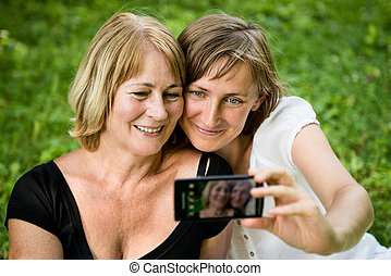 Senior mother with child taking picture