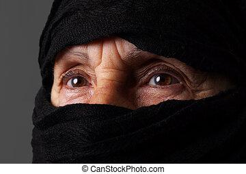 Senior muslim woman eyes - Eyes of senior muslim woman with...