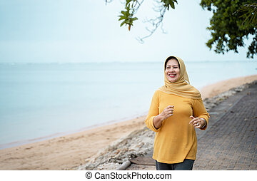 woman running and doing sport outdoor