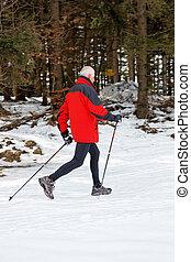senior nordic walking in winter - senior winter snow on the...