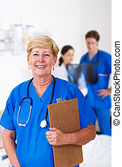 senior nurse - senior female nurse in hospital