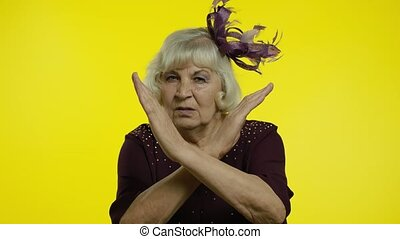 Don't do it. Senior old woman asking to stop and showing restrict gestures with hands, displeased with something shameful awful, ugly, danger. Elderly stylish lady grandma in studio. 6k footage