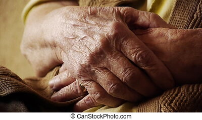 Senior old woman hand wrinkle skin close up