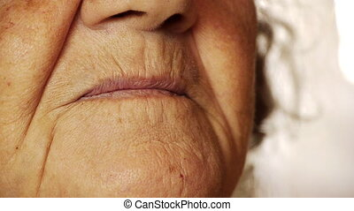 Senior old woman smile mouth wrinkle skin close up