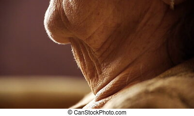 Senior old woman throat neck wrinkle skin close up