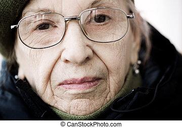 senior on the street - urban closeup portrait , focus point...