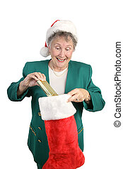 Senior Opens Christmas Stocking