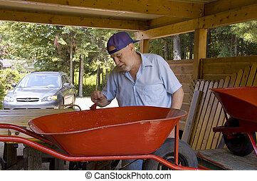 Senior painter 6 - Senior male painting a wheel barrow in ...