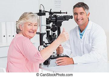 Senior patient gesturing thumbs up - Portrait of senior ...