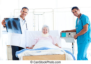 Senior patient looking at an x-ray with her doctor