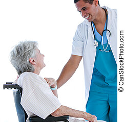 Senior patient sitting on a wheelchair talking with her doctor