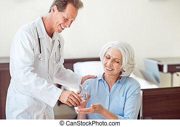 Senior patient taking pills