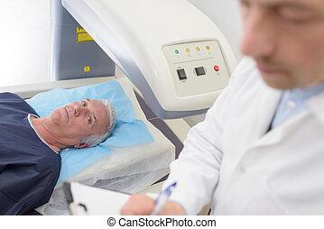 senior patient undergoing mri scan at hospital