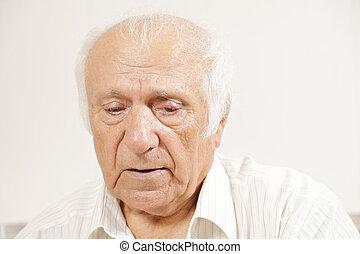 Senior pensive man in white shirt