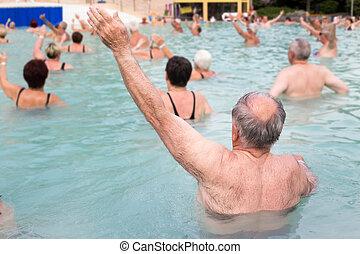 Senior people exercising in pool