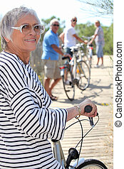 Senior people on bikes