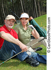 Senior people sitting on golf course