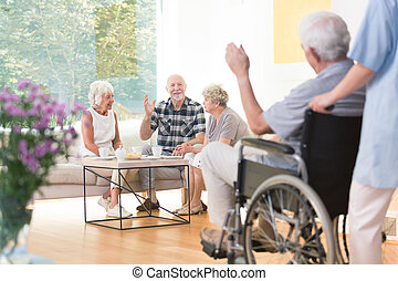 Senior people welcoming friend - Group of senior people...