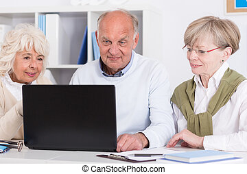 Senior people with laptop