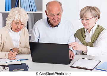 Senior people with laptop