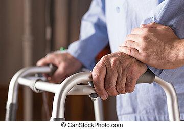 Senior person holding walking zimmer