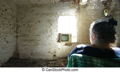 Senior person in abandoned house