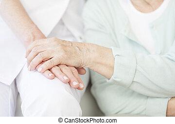 Senior person thanks the nurse
