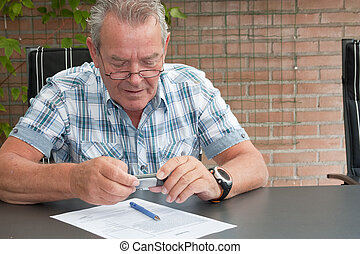 Senior photographing a legal document