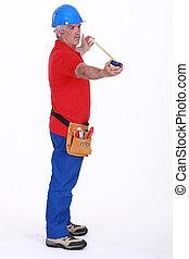 Senior plumber standing on white background