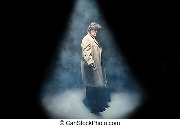 Senior police agent with a gun on dark smoke background