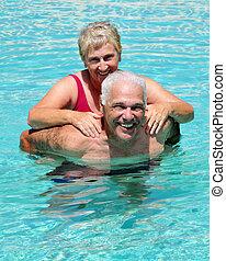 Senior Pool Fun - Seniors in a swimming pool, the wife ...