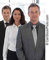 Senior positive Business team looking at camera