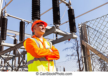 senior power plant technician with arms crossed