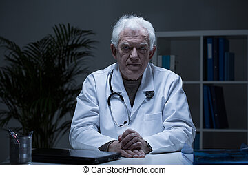 Senior practitioner in doctor's office