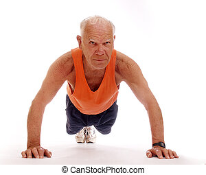 Senior Push-Ups - Healthy senior man working out by doing...