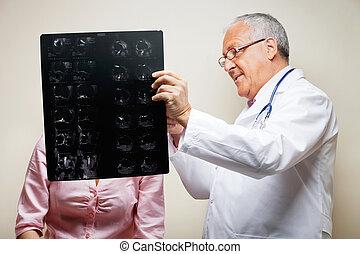 Senior Radiologist Holding X-ray - Senior male radiologist...