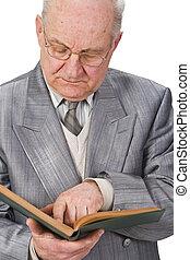 Senior reading a book