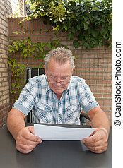 Senior reading a document