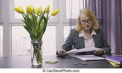 Senior real-estate agent working on documents