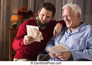 Senior recalling old times - Image of senior man recalling...
